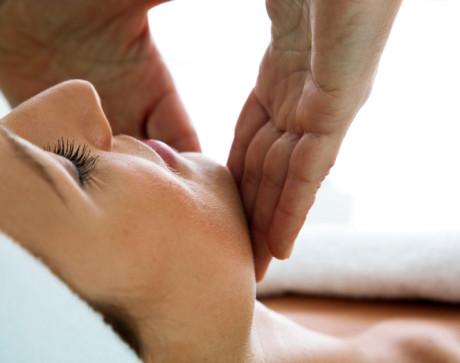 Woman Receiving a Head Massage